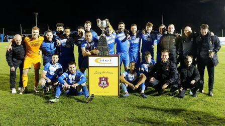 The Ipswich Wanderers players and management celebrate after winning the CNet Training Suffolk Senio
