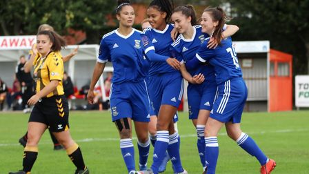 Sophie Peskett celebrates one of her two goals with Anna Grey and Eloise King Picture: Ross Halls