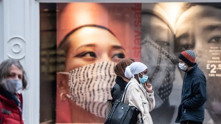 Members of the public walking past Primark in their face coverings. Picture: SARAH LUCY BROWN