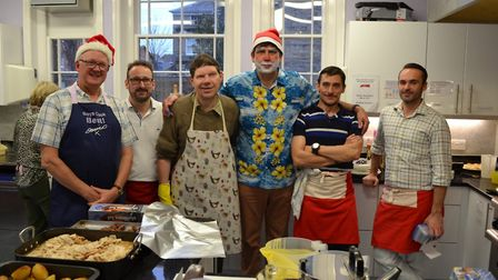 The team at the Christmas Present Trust making a turkey dinner Picture: Christmas Present Trust