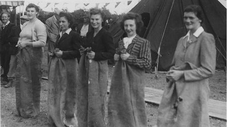 Betty French pictured (middle) at the village fete during the sack race. Picture: FRENCH FAMILY