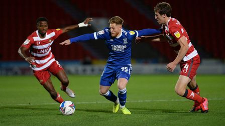 Teddy Bishop fights for the ball at Doncaster Rovers. Picture Pagepix Ltd