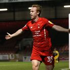 Danny Johnson of Orient scores the third goal for his team and celebrates during Leyton Orient vs Pl