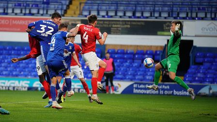 Oli Hawkins heads Ipswich Town into a 1-0 lead against Crewe Picture: STEVE WALLER