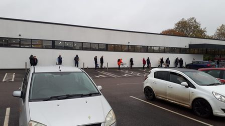 Queues have been forming outside the Aldi in Bury St Edmunds this morning. Picture: TONY MILDINHALL