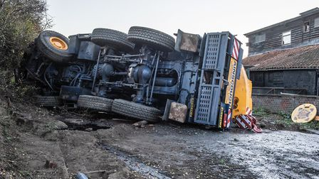 The crane truck overturned on Monday, October 26 on the A140 in Earl Stonham. Two people were inside