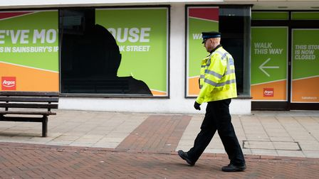 A police officer walks through Ipswich on day seven of lockdown Picture: SARAH LUCY BROWN