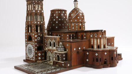 A rare 17th Century model of the Church of the Holy Sepulcher, Jerusalem, in olivewood, intricately