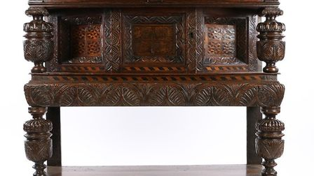 A late Elizabethan/James I oak & inlaid canted cupboard, English, Sussex, circa 1600 – 1610 which fe