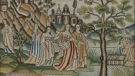 A fine mid 17th Century needlework with the discovery of Moses in the bulrushes, with figures repres