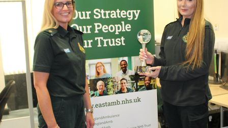 Nicola Turner, right, receiving her award from Helen Williams, ambulance operations centre quality a