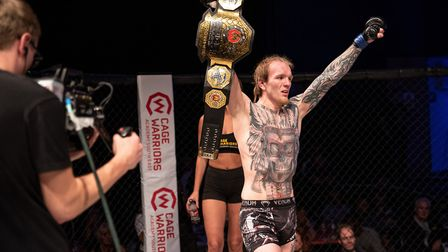 Jimmy Fell with the Cage Warriors Academy South East amateur featherweight belt - he's also the Contenders amateur 145lbs...