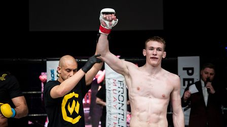 Connor Hayes has his hand raised as the new Cage Warriors Academy South East middleweight champion. Picture: BRETT KING