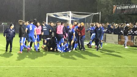 Leiston players and fans celebrate after their dramatic penalty shoot-out success over AFC Telford U