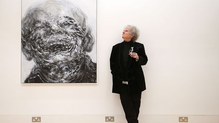 British artist Maggi Hambling stands next to her work 'Laughing' while attending her new exhibition
