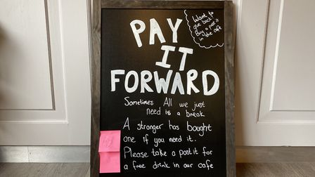 The 'pay it forward' board, where customers can donate a coffee to anyone who wishes to claim one Pi