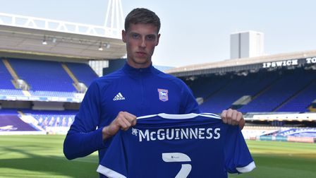 Ipswich Town signed Mark McGuinness on a season-long loan from Arsenal after he impressed against th