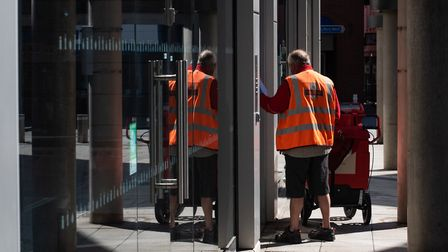 A Royal Mail worker delivering the post Picture: SARAH LUCY BROWN