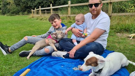 Luke Hearn with his two sons aged nine years old and five months old. Picture: HEARN FAMILY