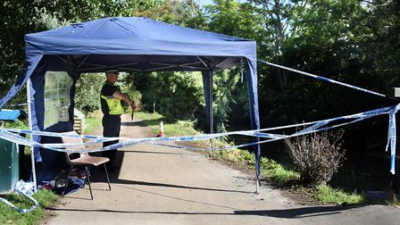Police taped off a footpath as a diving team searched the River Stour in Sudbury Picture: DENISE BRADLEY