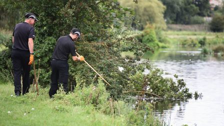 Police search the banks of the River Stour at Sudbury. Picture: DENISE BRADLEY