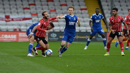 Jorge Grant has his ankle stood on by Luke Chambers at Lincoln City. Picture Pagepix