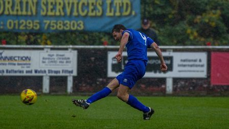 Ollie Hughes fires Bury Town into a 1-0 lead at Banbury United. Picture: NEIL DADY