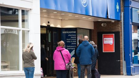 People waiting to get into Boots in Ipswich town centre Picture: SARAH LUCY BROWN
