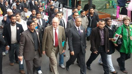 Triumphant Lutfur Rahman flanked by Ken Livingstone and supporters on Whitechapel walkabout campaign