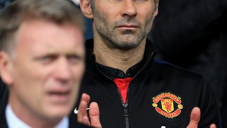 Axed Manchester United manager David Moyes and new 'interim manager' Ryan Giggs.