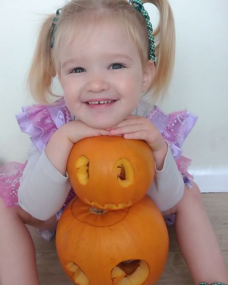 Eleanor who is aged two and from Ipswich, with her first pumpkin. Picture: LEAH WELLARD