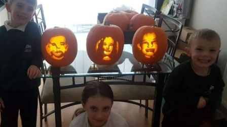 Tom, Mercedes and Lochlan with the pumpkins that their mum Ami carved of them. Picture: AMI C DOLAN