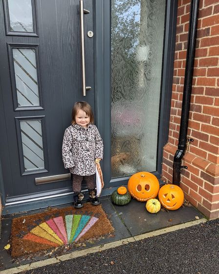 Gracie, aged two, with her pumpkins outside her house ready for Halloween. Picture: MUM EMMA