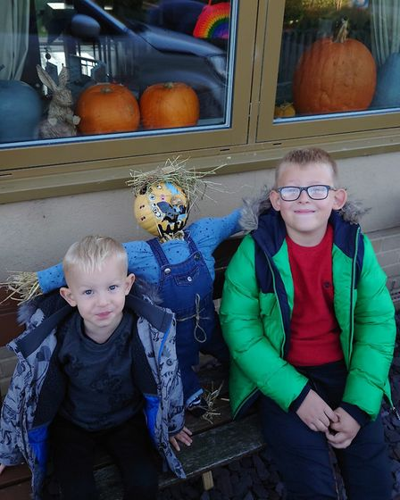 Oscar and Logan made a pumpkin scarecrow. Picture: LAURA COLLINS