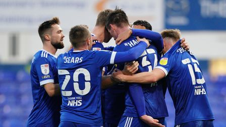 Town players surround Oli Hawkins after he had scored the only goal in the victory over Crewe Alexan