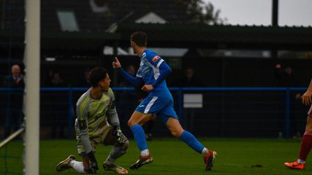 Liam Jackson tucks home Leiston's first goal during a dramatic FA Trophy clas hagainst Worthing at V