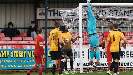Needham Market keeper Marcus Garnham turns a cross over the bar during his side's FA Trophy win over