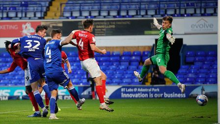 Oli Hawkins heads in the only goal of the game against Crewe Alexandra. Picture: Steve Waller