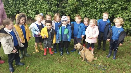 Pupils from Woodhall Primary School with Baxter the dog. Picture: TRACY TATE/WOODHALL PRIMARY SCHOOL