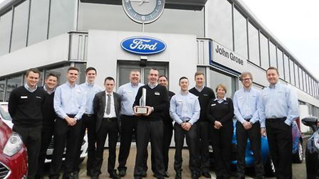 John Grose staff with the record-breaking Ford Chairmans Award for customer satisfaction.