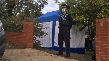 An officer outside the property in Bridgewood Road, Woodbridge Picture: ARCHANT