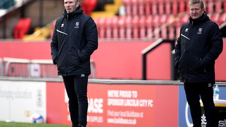 Lincoln City manager Michael Appleton and assistant David Kerslake (right). Appleton was pleased wit