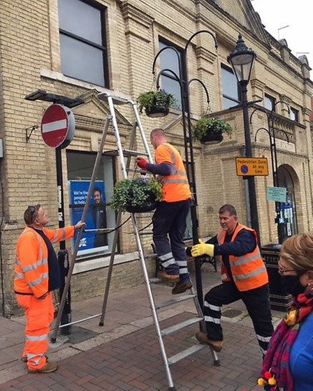 The West Suffolk Council team take great care putting up the 48t 20kg baskets. Picture: BURY IN BL