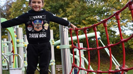 Daltyn playing on the new Saxmundham Adventure Playground climbing frame. Picture: CHARLOTTE BOND