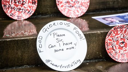 Empty plates on the steps of Ipswich Town Hall to protest against the government's recent free schoo