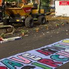 Banners and flowers stop mechanical digger in its tracks at Arnold Circus. Picrture: Nicola Contini
