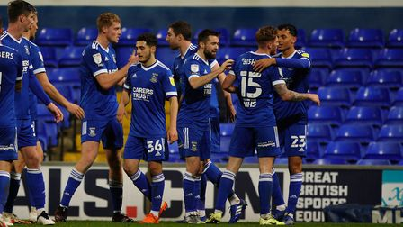 Town players celebrate Teddy Bishops goal in the 1-0 victory over Gillingham. Picture: Steve Wal