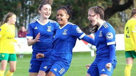 Eloise King celebrates her goal with Anna Grey and Sophie Peskett in the Blues 3-1 win at Norwich in