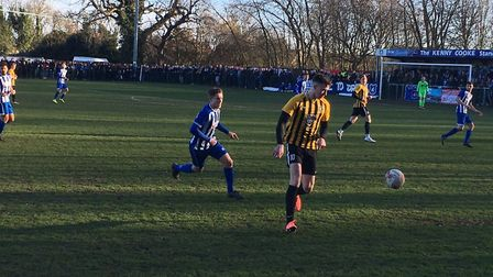 Stowmarket Town striker Josh Mayhew on the ball at Wroxham in the Vase last season. The two clash ag