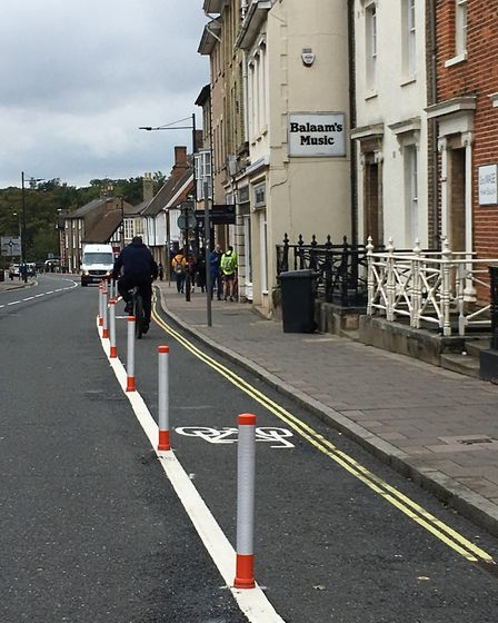 The new cycle lane in Risbygate Street is to support walking and cycling and has been funded thrroug